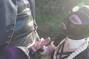 Miss Maskerade sit-in in full rubber french maid adventure outdoor giving latex blowjob