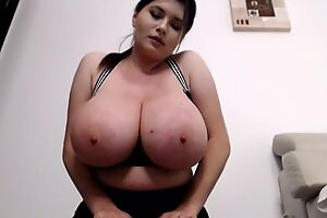 Unobscured brunette flashes her massive boobs on cam