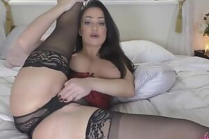 Gorgeous mom with juicy titties masturbates in bed