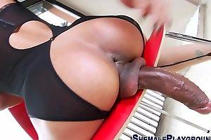 Shemale tugs her big cock