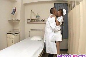 Aya hot nurse takes uniform off to suck and stroke two shlongs