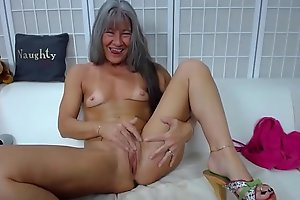 Adept sassy mature Leilani dirty talking and acquires cream