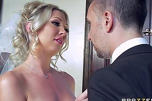 Lexi Lowe receives twosome pick up flannel before the nuptial