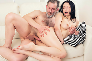 Older but still strong man thrusts his dick deep into a fresh throat coupled with pussy of his younger brunette girlfriend from behind.