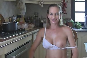 Juggy wife strips and masturbates surrounding the kitchen